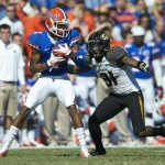 Jonathon Bostic (1) gets a first down for the Gators in the first half of Saturday's game against the Missouri Tigers.