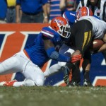 Defensive lineman Dante Fowler (6) makes a tackle for the Gators to stop a missouri first down in the first half of Saturday's game.