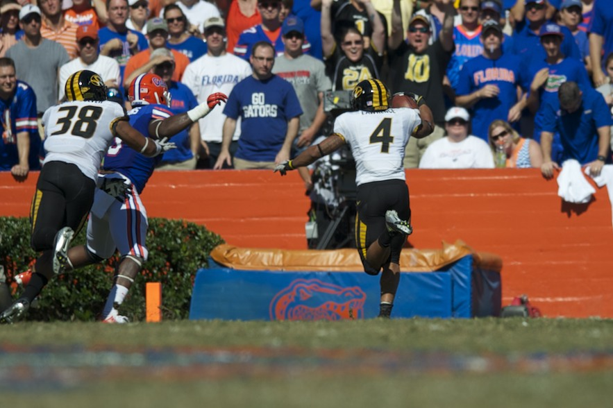 Tailback Kendial Lawrence (4) puts Missouri on the board with a touchdown in the first quarter of Saturday's game.