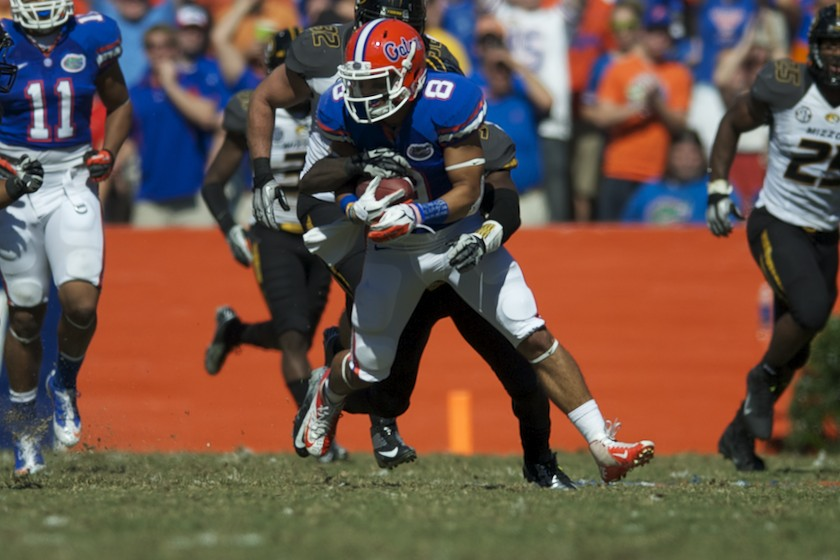 Florida runningback Trey Burton (8) gets tackled in the second half of Saturday's game against the Missouri Tigers.
