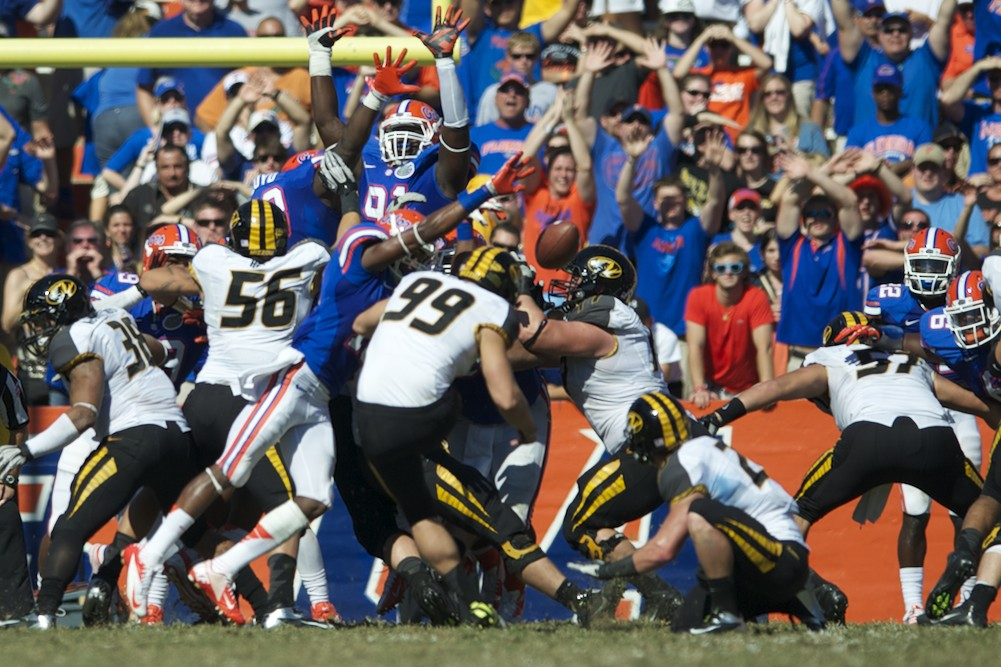 Defensive back Loucheiz Purifoy (15) had a key block to keep the score tied at 7-7, rather than Missouri taking back the lead in Saturday's game.