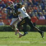 Trey Burton gets tackled after a first down for the Florida Gators in the second half of Saturday's game.