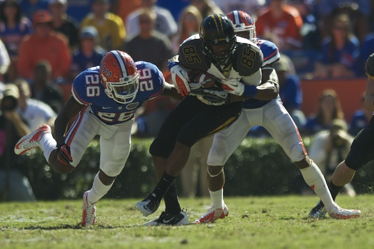 Florida defense takes down Missouri's Marcus Lucas (85) to prevent a first down during Saturday's game.