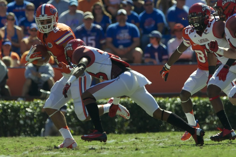 Runningback Trey Burton (8) gets a first down for the Florida Gators in the second half of Saturday's game against Louisiana's Ragin' Cajuns.