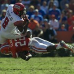 Florida's Matt Elam (22) tackles Louisiana's Harry Peoples (9) to prevent a Louisiana first down.