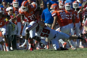 Omarius Hines (20) is taken down after a Florida first down in the second half of Saturday's game.