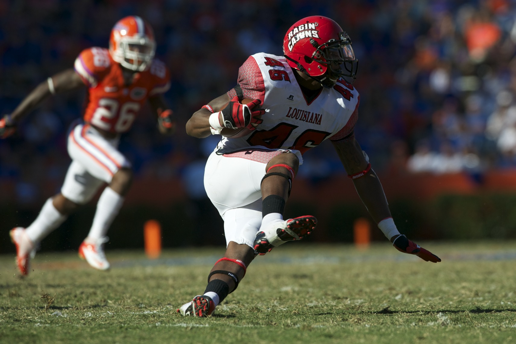 Runningback Alonzo Harris (46) gets a first down for Louisiana's Ragin' Cajuns in the second half of Saturday's game.