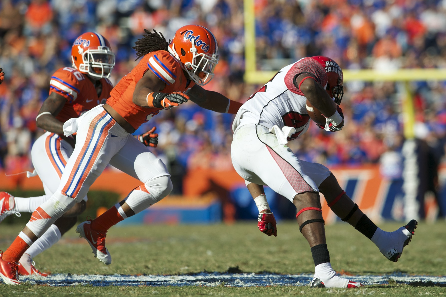 Florida defense takes down ball carrier Alonzo Harris (46) after a Louisiana first down.