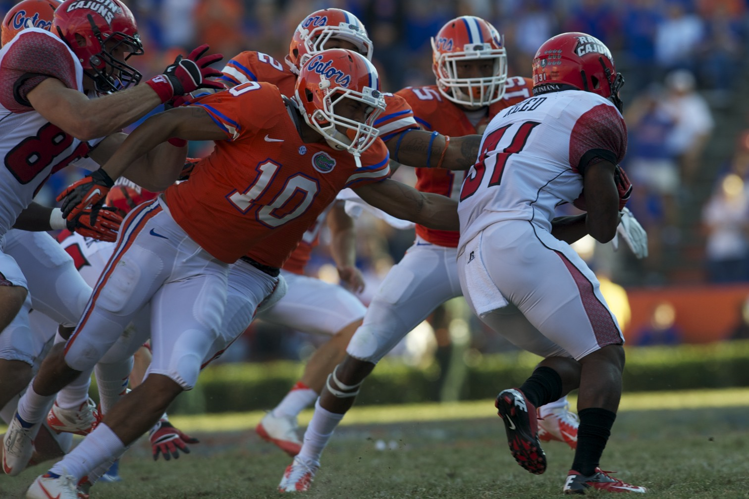 Florida defense takes down ball carrier Effrem Reed (31) in the fourth quarter of Saturday's game to prevent a Lousisiana first down.