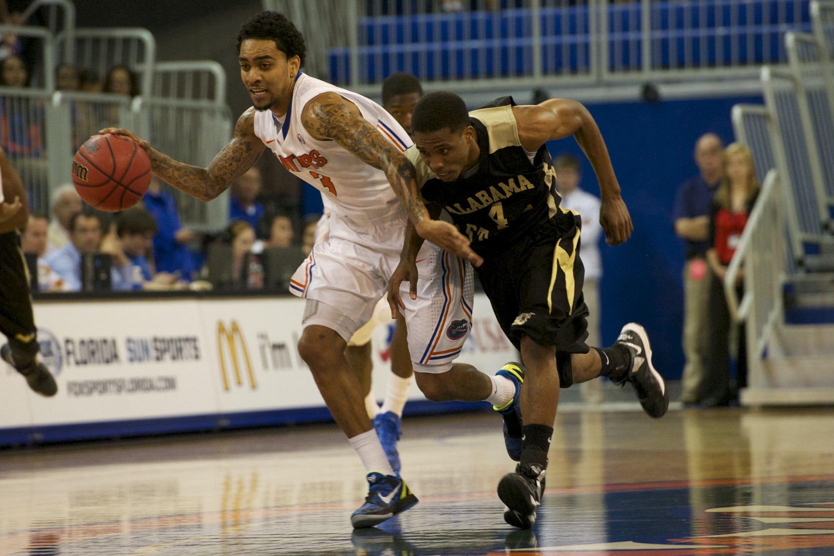 Kenny Boynton (1) dribbles down the court in the first half of Sunday afternoon's game against Alabama State.