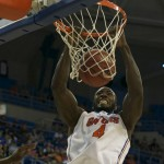 Junior Patric Young (4) slam dunks for the Florida Gators in the first half of Sunday's game.