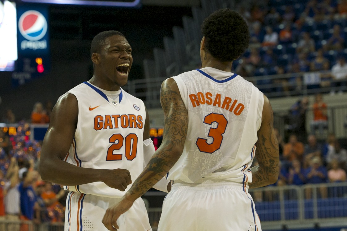 Michael Frazier (20) and Mike Rosario (3) celebrate after Rosario scores for the Gators.