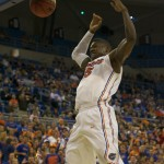 Will Yeguete (15) slam dunks in the first half of Sunday's game.