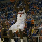Junior Patric Young (4) slam dunks for the Florida Gators in the second half of Sunday's game.