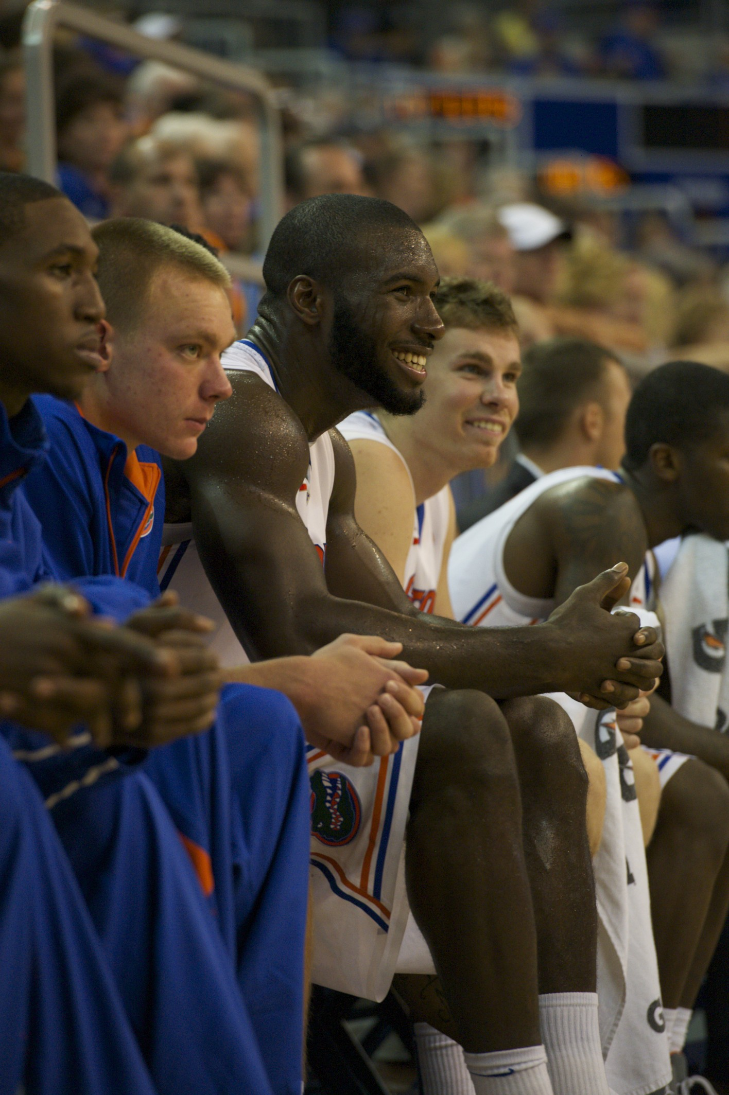 Patric Young (4) and Erik Murphy (33) watch their teammates in the second half of Sunday's game.