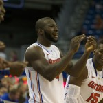 Patric Young (4) cheers on his teammates during the second half of Sunday's game.