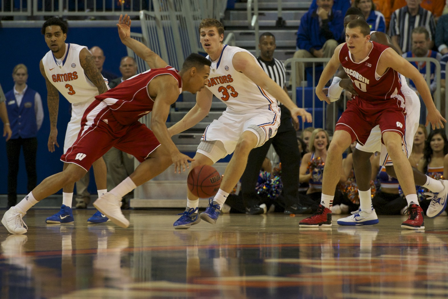 Wisconsin player attempts to pass Florida defender Erik Murphy (33) and put points on the board for his team in the first half of Wednesday's game.