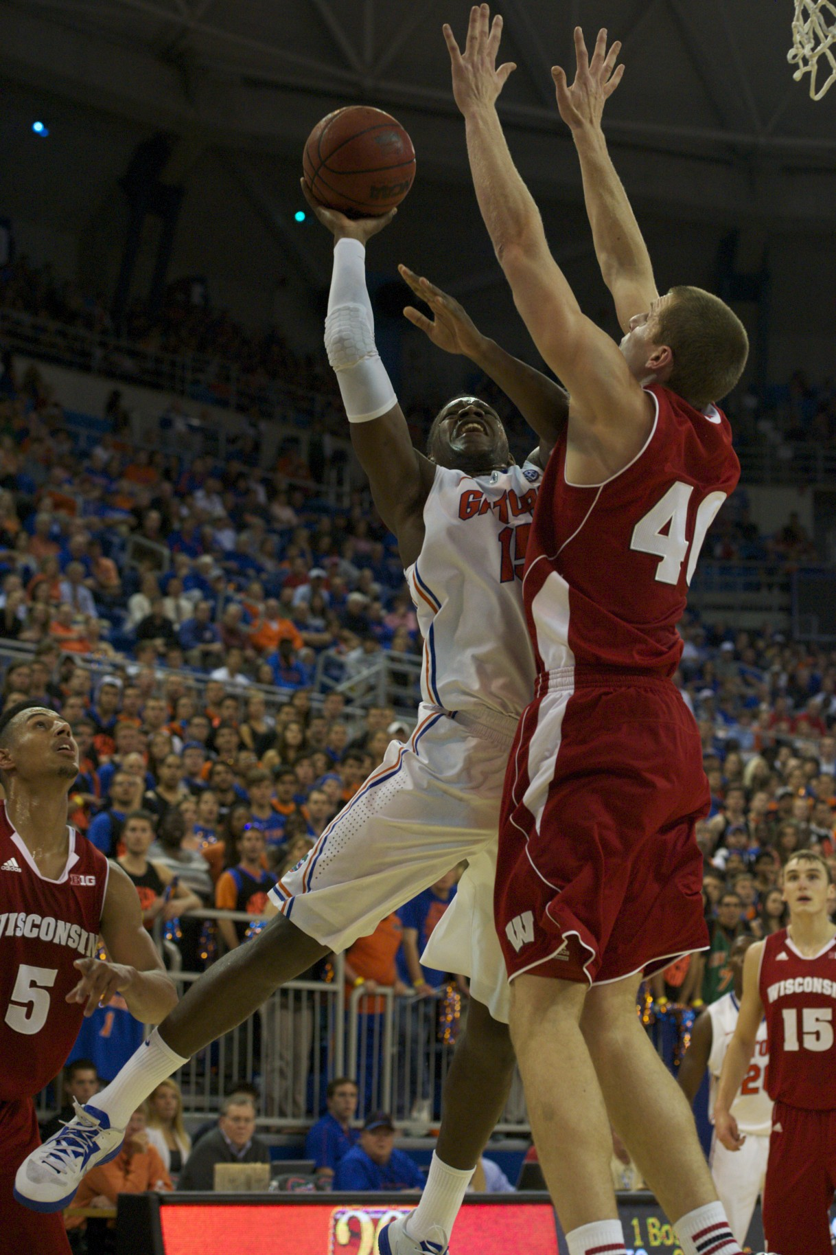 Will Yeguete (15) scores on Wisconsin defender Wednesday night.