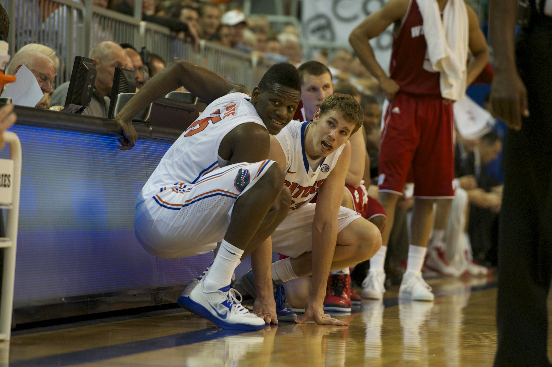 Will Yeguete (15)and Erik Murphy (33) wait on the sidelines to be put in the game Wednesday night.
