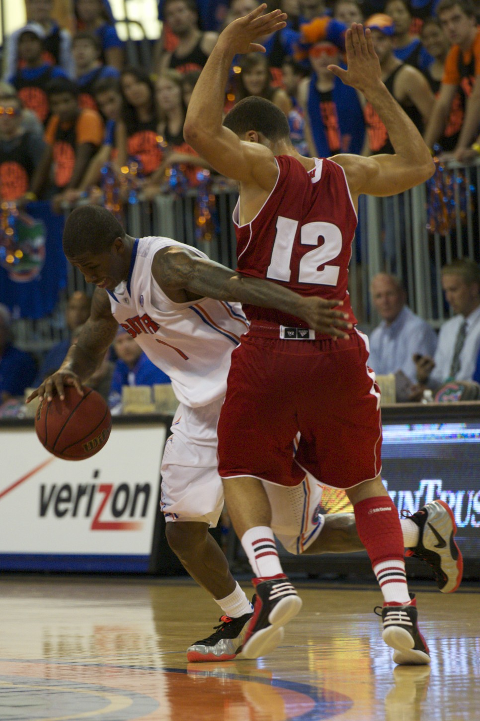 Kenny Boynton (1) passes Wisconsin defender to make a play for the Florida Gators Wednesday night.