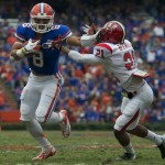 Running back Trey Burton (8) gets a first down for the Gators in the first half of Saturday's game.