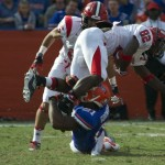 Florida Jabari Gorman (21) tackles Jacksonville State Gabriel Chambers (82) behind the line of scrimmage in the third quarter on Saturday.