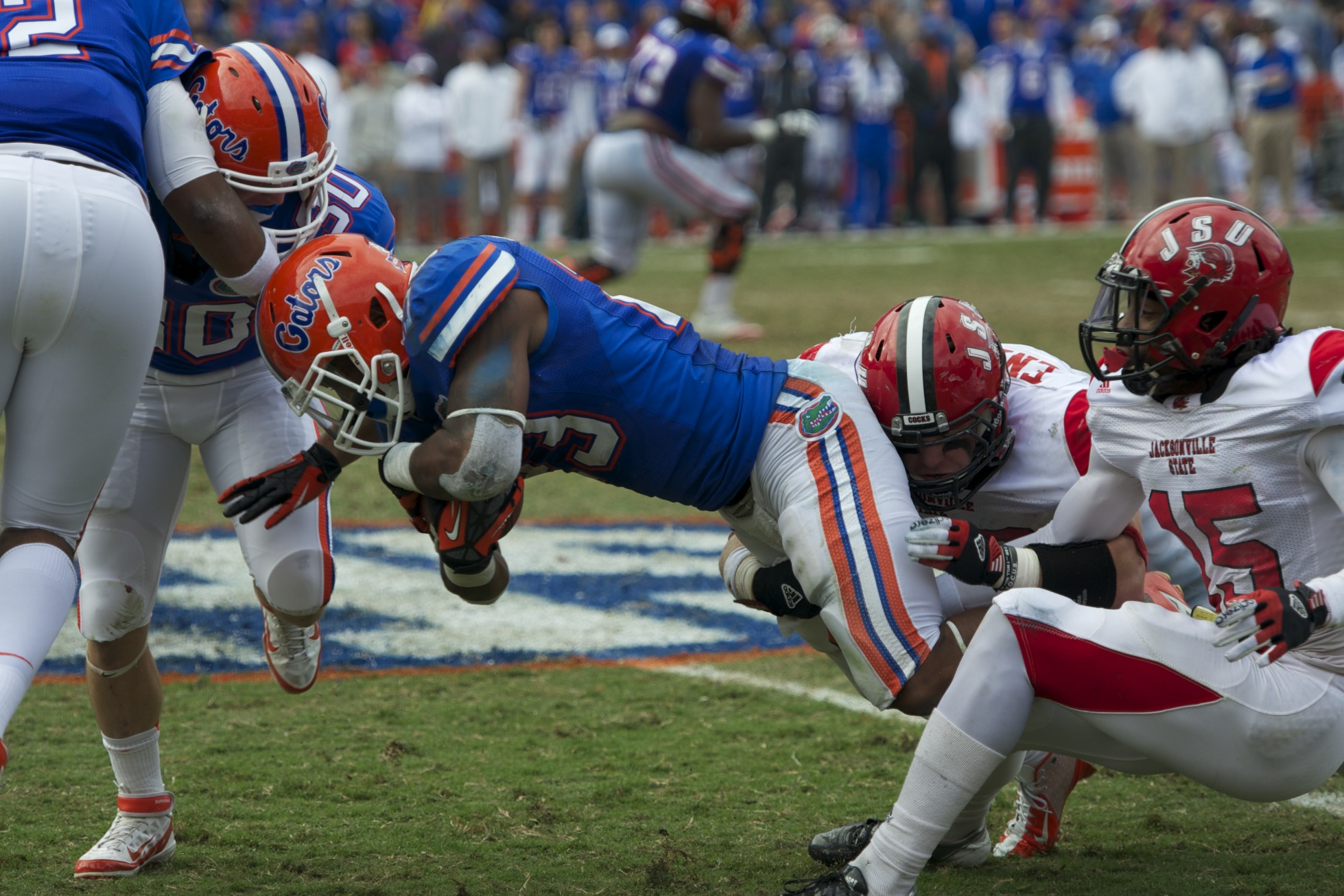 Mike Gillislee (23) is taken down by Jacksonville State defense in the second half of Saturday's game.