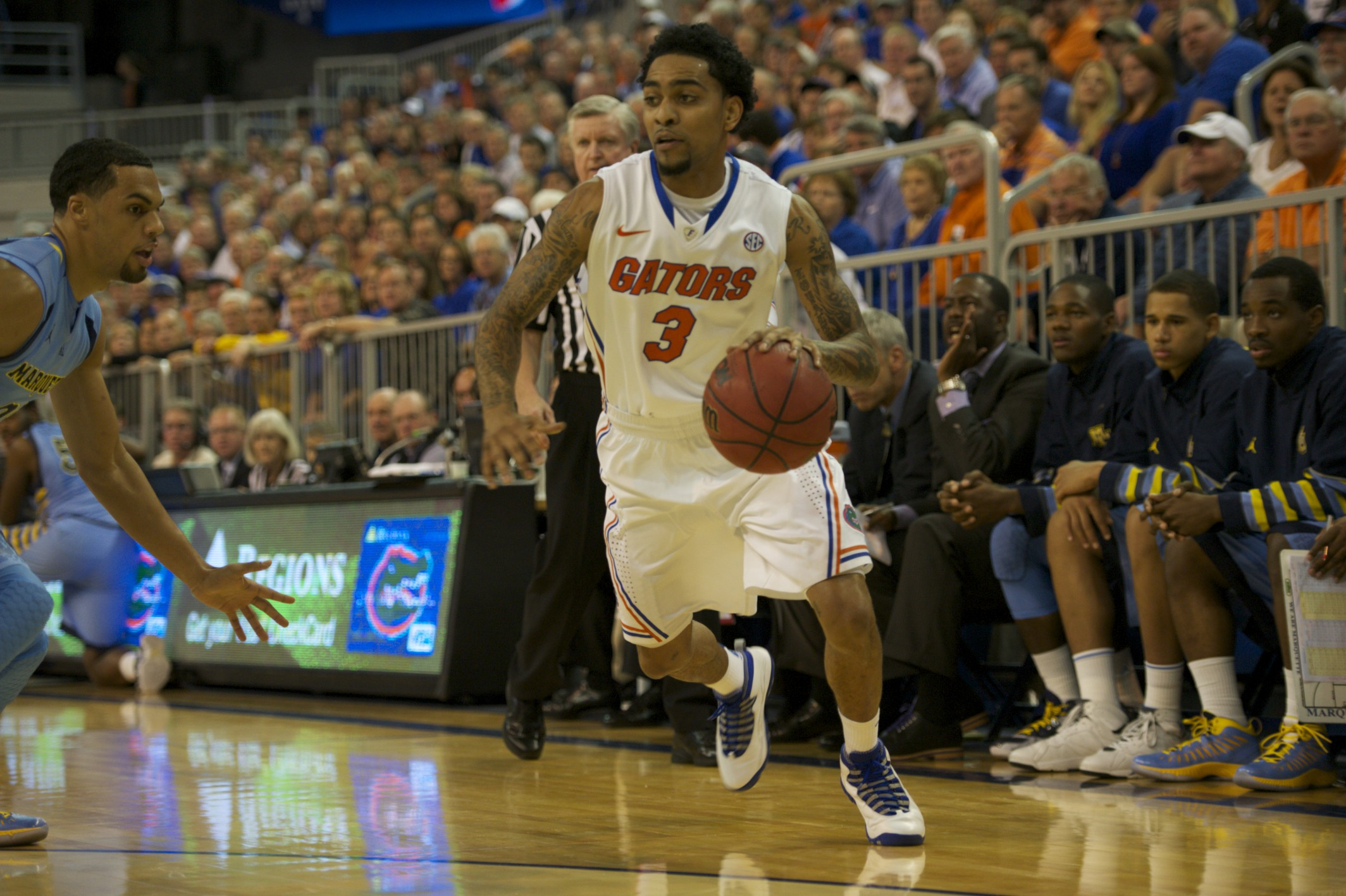 Mike Rosario (3) brings the ball down the court to put Florida on the score board at the start of Thursday's game.