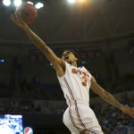 Mike Rosario (3) reaches for a lay up and scores for the Gators Thursday night against the Marquette