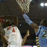 Patric Young (4) takes on a Marquette defender to score for the Gators in the first half of Thursday's game.