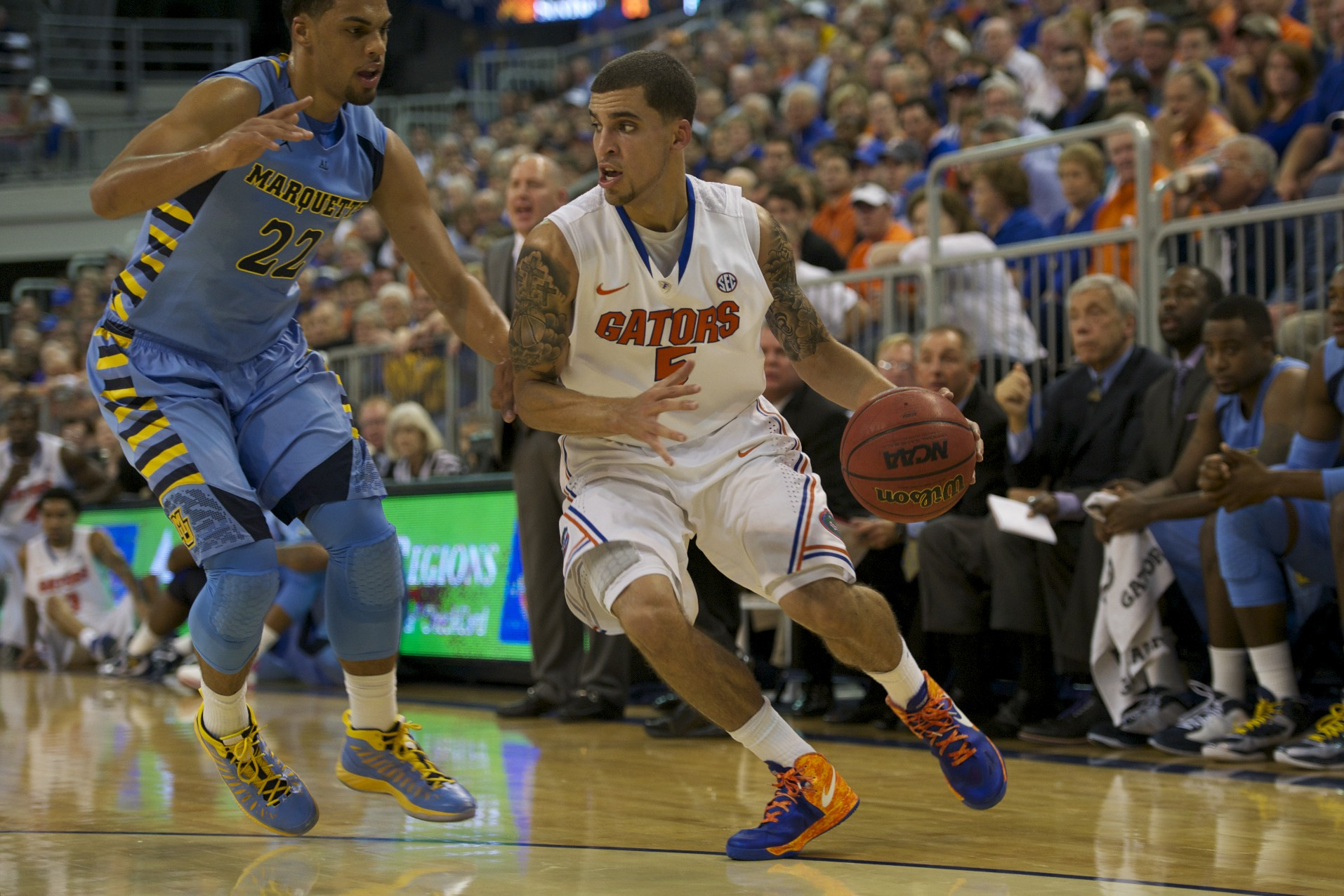 Scottie Wilbekin (5) brings the ball down the court for Florida points Thursday night.