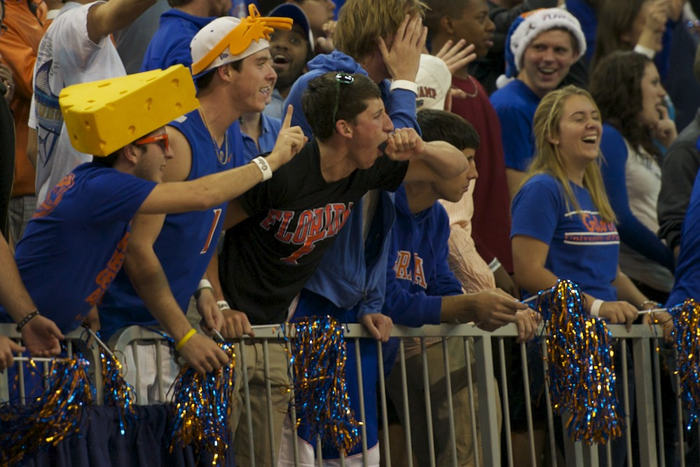 Fans celebrate after Patric Young (4) blocks down a Marquette shot Thursday night.