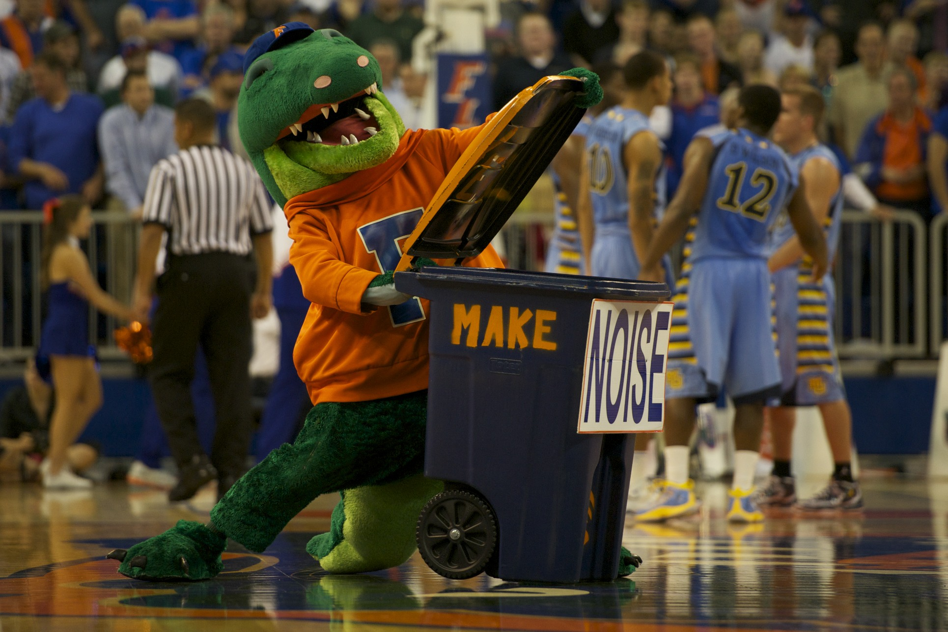 "Florida mascot Albert encourages the crowd to ""make noise"" during a timeout during Thursdyay's game."