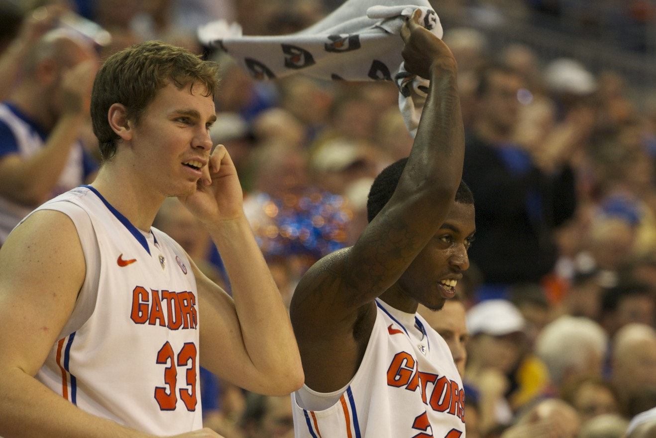 Erik Murphy (33) and Casey Prather (24) celebrate from the bench late in the second half of Thursday's game.