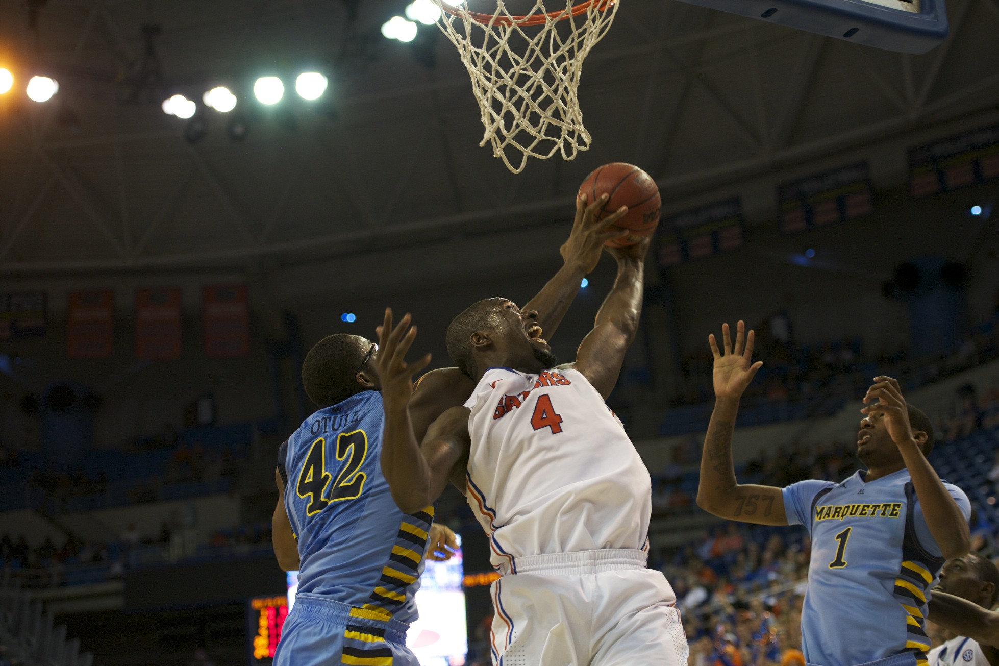 Patric Young (4) gets a rebound for the Gators in the second half Thursday night.