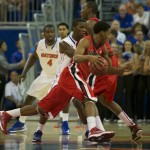 Georgia's Vincent Williams (11) evades Florida defense in the first minutes of Wednesday's game in hopes of putting points on the board.