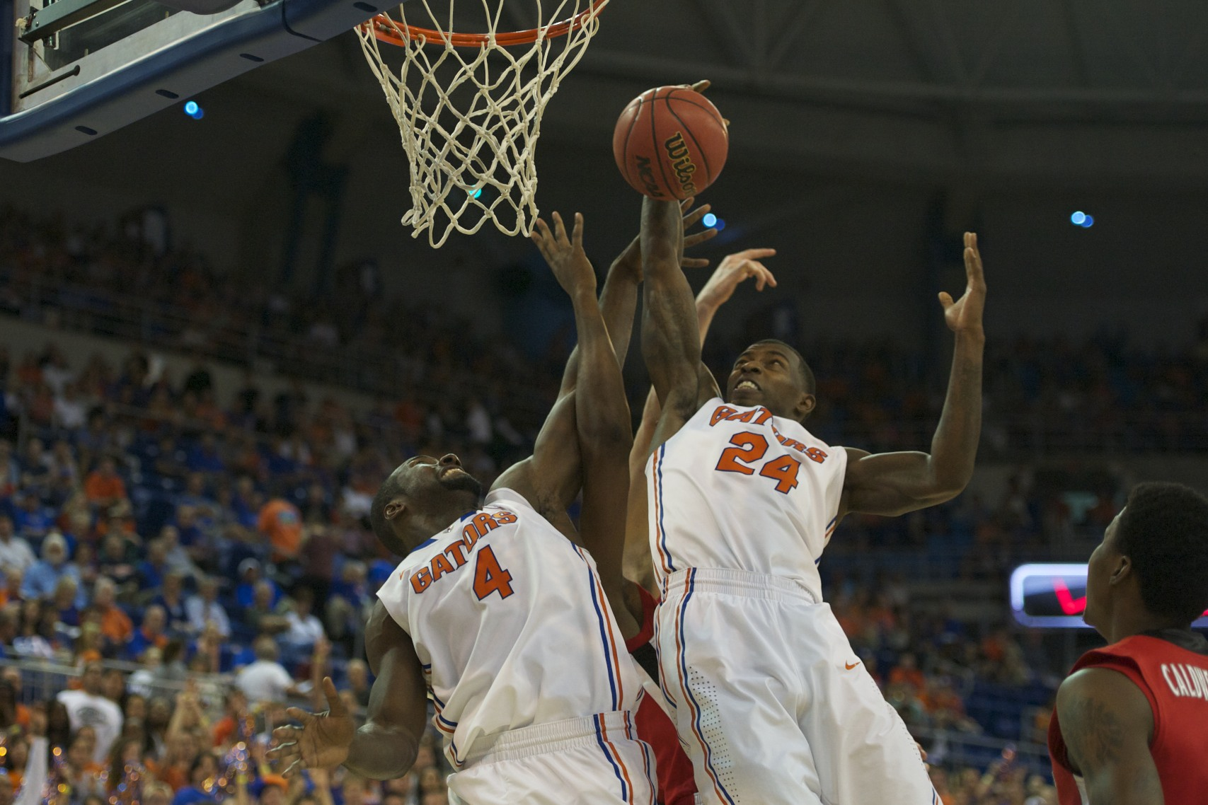 Patric Young (4) and Casey Prather (24) fight for a Florida rebound in the first half of Wednesday night's game.