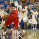 Will Yeguete (15) plays defense against Georgia's Vincent Williams (11) in the first half of Wednesday's game.