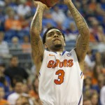 Florida guard Mike Rosario (3) was the lead scorer Wednesday night for the Gators with 19 points.