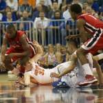 Erik Murphy (33) and Scottie Wilbekin (5) fight for a steal for the Gators Wednesday night against the Georgia Bulldogs.