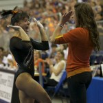Marissa King celebrates after her vault Friday night against the Kentucky Wildcats.