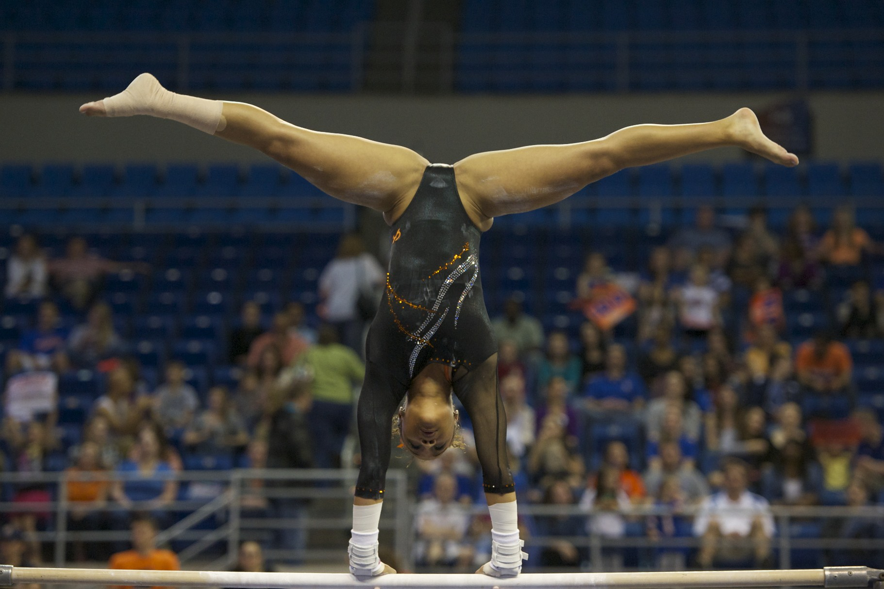 Freshman Kytra Hunter on bars