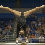 Marissa King competes on bars Friday night against Kentucky.