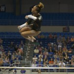 Kytra Hunter competes on bars Friday night.