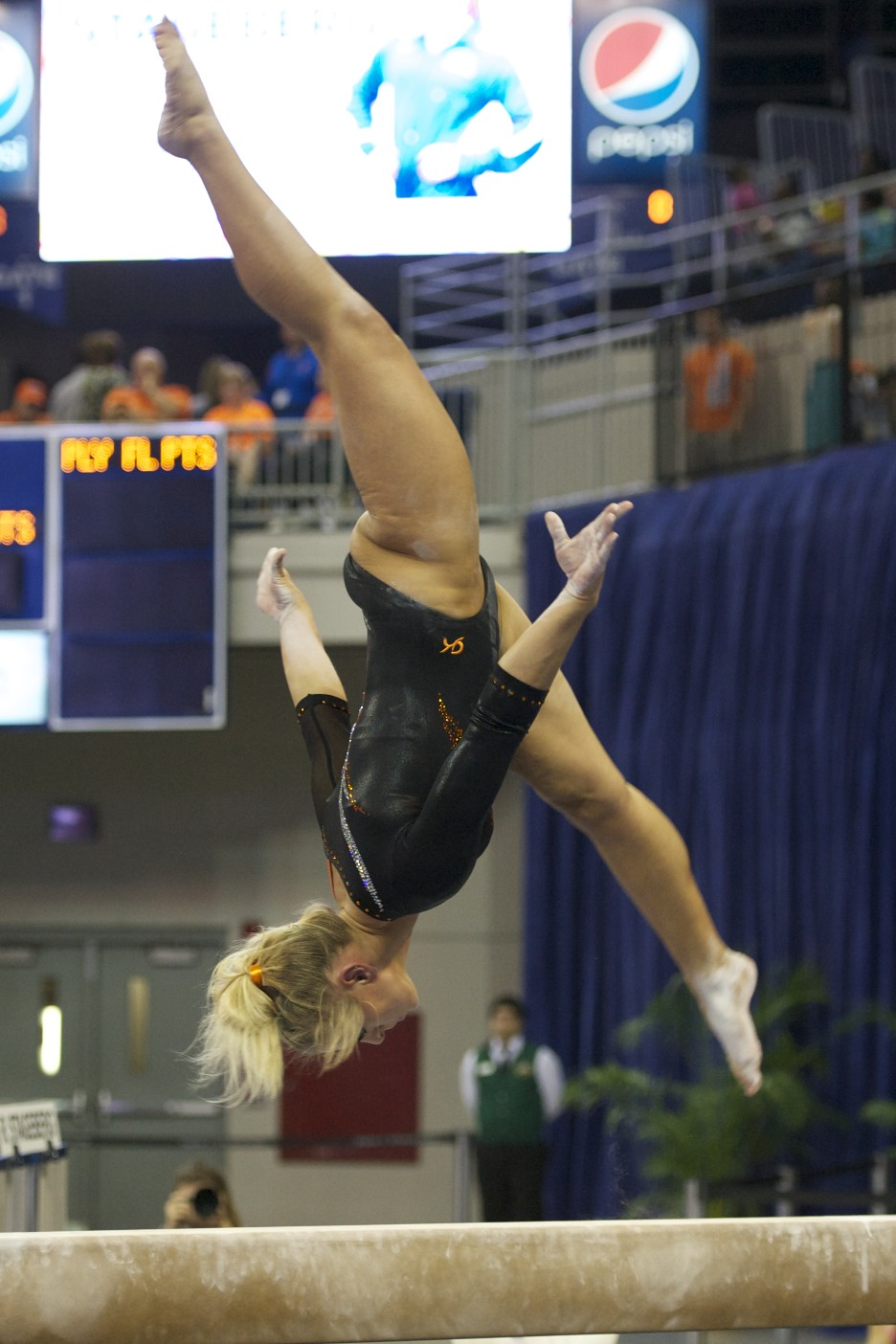Randy Stageberg competes on beam Friday night.