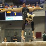 Randy Stageberg competes on beam Friday night against the Kentucky Wildcats.