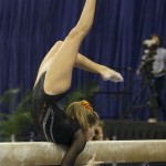 Mackenzie Caquatto competes on beam during Friday night's meet against Kentucky.