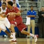 Michael Frazier (20) plays defense against Arkansas Saturday night.
