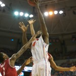 Patric Young (4) goes for a lay up in the first half of Saturday's game against Arkansas.