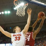 Erik Murphy (33) reaches for a rebound in the second half of Saturday's game.